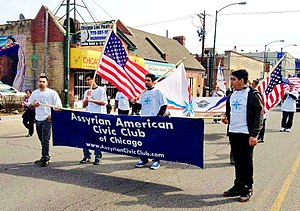 Assyrian Americans - Assyrian-Americans have a long history in Chicago; they are seen here in a protest march carrying American and Assyrian flags