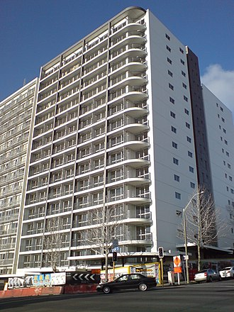 """Auckland CBD - Late 2000s apartment block on Nelson Street, considered by some to be an """"eyesore"""". Many of these buildings saw strong criticism - and sometimes lack of tenant interest - due to perceived problems with building quality, lack of urban design and too-small unit sizes (with a bylaw banning very small units coming in only in 2005)."""