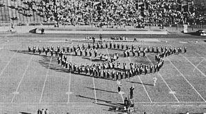 "University of Pittsburgh Varsity Marching Band - During the 1950s, the Pitt Band, shown here during the 1952 Pitt football season, would close halftime shows playing the ""Alma Mater"" in the Panther Head formation."