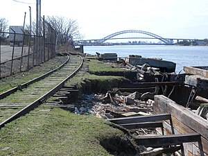 Staten Island Railway - The abandoned North Shore Branch. The Bayonne Bridge can be seen in the background