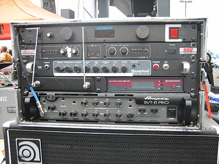 A bass rack from a professional bass player's touring setup. The bass amplifier is the lowest chassis in the rack; above it are a wireless receiver, several pre-amplifier devices, and a power conditioner. Bass rig.jpg
