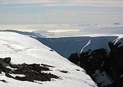 View south-west from the summit in early April. When the cliff edges are corniced, accurate navigation is critical.
