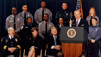 Janet Reno - Reno looks on as Sen. Joe Biden speaks at the signing of the 1994 Biden Crime Bill