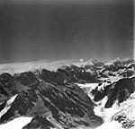 Brady Glacier and Lamplugh Glacier, icefall near mountain peaks, August 23, 1976 (GLACIERS 5900).jpg