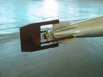 Aerial torpedo - Breakaway wooden fins help stabilize the torpedo in the air. They grip the metal fins only by friction, and are forced off on entry into the water.