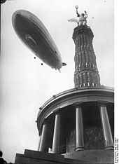 """the victory column with the airship """"Graf Zeppelin"""""""