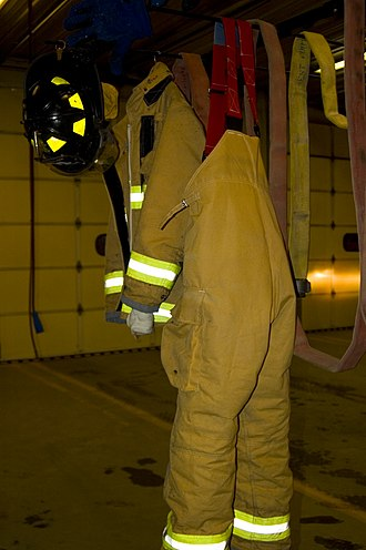 Bunker gear - Turnout trousers hanging on a hose drying rack after getting wet at a fire call.