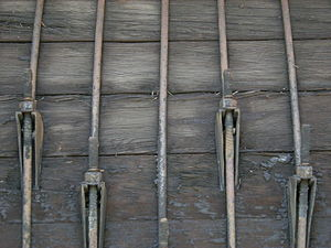 Seattle Public Utilities - Closeup view of a section of the wooden pipe that brought Cedar River water to Seattle from 1930 to 1991. Metal bands hold the pipe together. This section is now on display in Maple Valley, Washington.