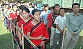 Chakma tribal girls in their traditional attires standing in a queue to cast their votes at a polling booth at Gautampur village in Changlang district of Arunachal Pradesh on May 5, 2004.jpg