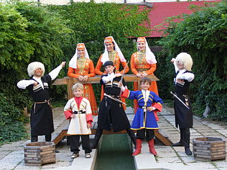 Israelis - Circassian youth showcasing traditional male and female Circassian costumes in Israel