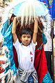 Chinese New Year 2014 in Kolkata - Child Enjoying in Dragon Dress.jpg