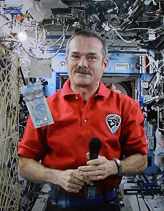 Chris Hadfield - Hadfield answering media questions during unveiling of the Canadian $5 Frontier Series banknote during Expedition 35 on April 30, 2013. He unveiled the $10 banknote on the same day.