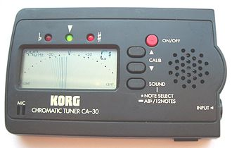 Electronic tuner - Pocket-sized Korg chromatic LCD tuner, with simulated analog indicator needle