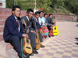 Chinlili - A group of musicians from Peru. The two smaller instruments with diatonic fretting are Chinlilis.