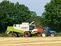 Claas combine and a blue tractor, Overtown, Swindon - geograph.org.uk - 533398.jpg