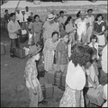 Closing of the Jerome Relocation Center, Denson, Arkansas. Jerome residents with their hand luggage . . . - NARA - 539816.tif
