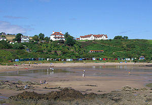 Coldingham Bay - The north side of the beach showing the beach huts with the Dunlaverock House hotel and the St Abb's Haven Hotel above.