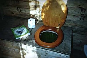 Composting toilet - Inexpensive do-it-yourself compost toilet at Dial House, Essex, England, utilizing an old desk as the toilet unit.