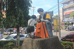 Mano (gesture) - A monument in Iriga City showing pagmamano