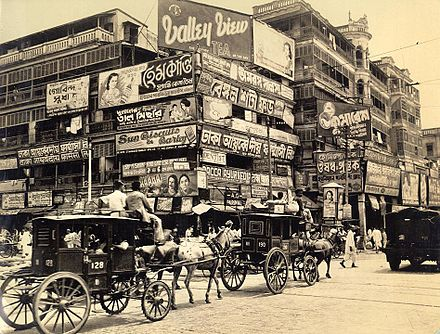 Bengali billboards on Harrison Street. Calcutta was the largest commercial centre in British India. Corner of Harrison Street (Burra Bazar) and Strand Road, Calcutta in 1945.jpg