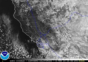 California Current - The lack of clouds along the coast (and also along the Central Valley of California) is due to an offshore wind blowing drier air from the land offshore.