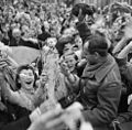 Crowd of Dutch civilians celebrating the liberation of Utrecht by the Canadian Army.jpg