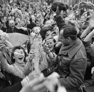 Dutch civilians celebrating the arrival of I Canadian Corps troops in Utrecht after the German surrender, 7 May 1945. Crowd of Dutch civilians celebrating the liberation of Utrecht by the Canadian Army.jpg