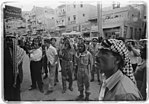 Crowds in downtown Amman watching a news report about King Faisal's deposition 14 July 1958.jpg