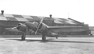 Curtiss YA-14 in front of hangar.jpg