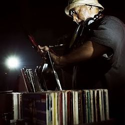 "American producer ""DJ Premier"" Looking through his vinyl record collection for potential samples"