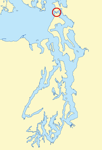 Located in the northern Puget Sound region, Deception Pass (circled in red) connects the Strait of Juan de Fuca (to the west) to Skagit Bay (to the east). Fidalgo Island is to the north and Whidbey Island is to the south.