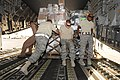 Defense.gov News Photo 100929-F-9209C-411 - U.S. Air Force airmen from the 451st Aerial Port Flight push a pallet of cargo as they unload a C-17 Globemaster III aircraft at Kandahar Airfield.jpg