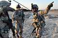 Defense.gov News Photo 110214-A-WO967-004 - U.S. Army Sgt. 1st Class Daniel Bush with Headquarters Company 1st Battalion 68th Armor Regiment directs U.S. soldiers out of the landing zone as.jpg