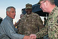 Defense Secretary Chuck Hagel, left, greets Gen. Lloyd J. Austin III, commander, U.S. Central Command, middle, and Vice Adm. John Miller, commander, U.S. Naval Forces Central Command, U.S. 5th Fleet, Combined 131206-N-IZ292-023.jpg