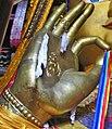 Dharmacakra on hand, Maitreya Buddha in Tibet (cropped).jpg