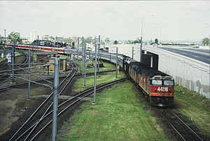 New South Wales 442 class locomotive - 44216 and another haul the northbound Brisbane Limited across the Corinda line at Yeerongpilly in 1987