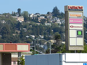 Eastmont Town Center - Eastmont Town Center sign, with the Oakland Hills in background