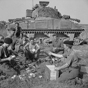 Northamptonshire Yeomanry - Crew from the Northamptonshire Yeomanry eating rations during Operation Totalize