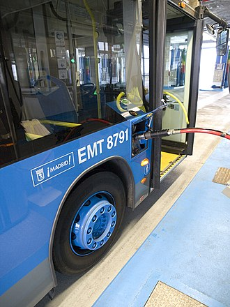 Compressed natural gas - CNG powered bus in Madrid, Spain being refueled.
