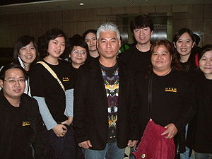 Eric Moo - Eric Moo (5th from right) and his fans.