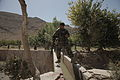 Executive Officer from Afghan National Army 2nd Candac 205th Corp, cross an aqueduct as Soldiers from the 1st Battalion, 24th Infantry Regiment, 1st Stryker Brigade Combat Team, 25th Infantry Division, perform 110920-A-AZ411-015.jpg