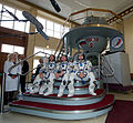 Expedition 31 backup crew members in front of the Soyuz TMA spacecraft mock-up in Star City, Russia.jpg