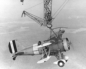 "Parasite aircraft - A Curtiss F9C Sparrowhawk attached by a ""skyhook"" to USS ''Macon''."