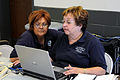 FEMA - 44156 - FEMA Community Relations Workers work with a computer at the Disaster Center in MS.jpg