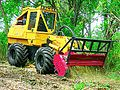 Fecon hydraulic mulching attachment on rubber-tired tractor.jpg