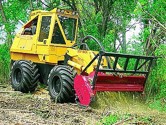 Forestry mulching - Hydraulic-powered mulching attachment on rubber-tired tractor
