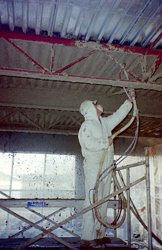 Fireproofing - Spray gypsum-based plaster fireproofing being installed.