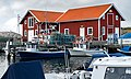 Fishing boats and utility houses in Norra Grundsund harbor.jpg