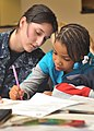 Flickr - Official U.S. Navy Imagery - Sailor writes notes of encouragement with student..jpg
