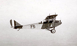 "March Air Reserve Base - A Curtiss JN-4 ""Jenny"" on a training flight during World War I. This is the type of aircraft used at March Field during this era for basic pilot training of military pilots."